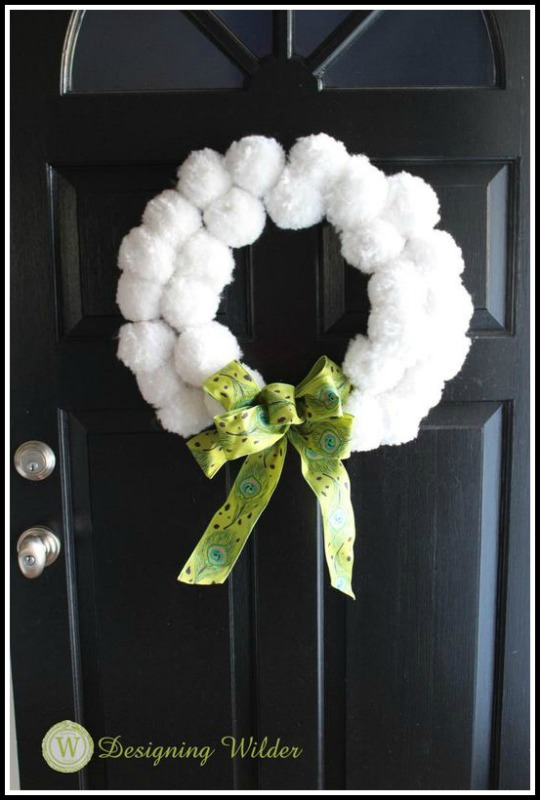 Finished pom pom wreath on front door