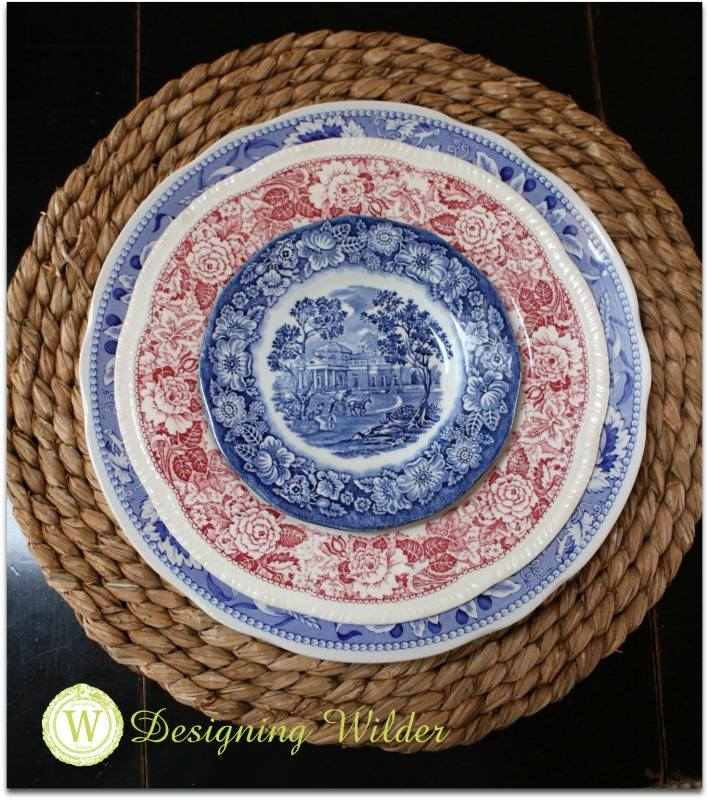 Place setting of mismatched transferware plates