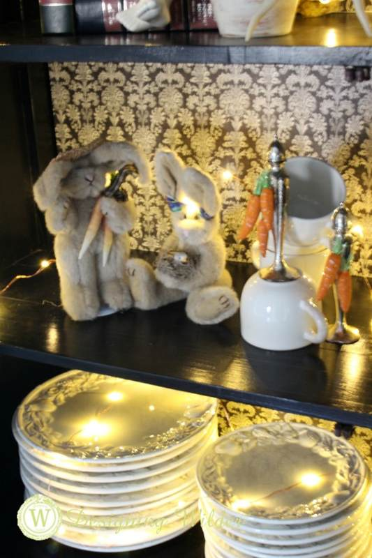 Bunny couple worked into display in farmhouse cabinet.