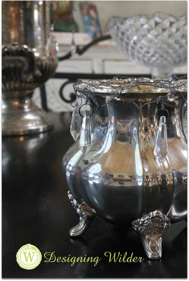 Silver tea set vase with flower bonnet.