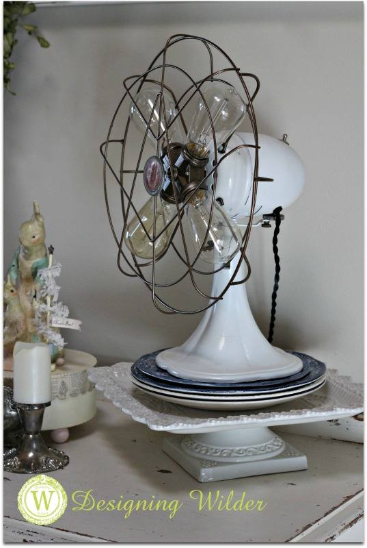Stacked plates add height under fan lamp