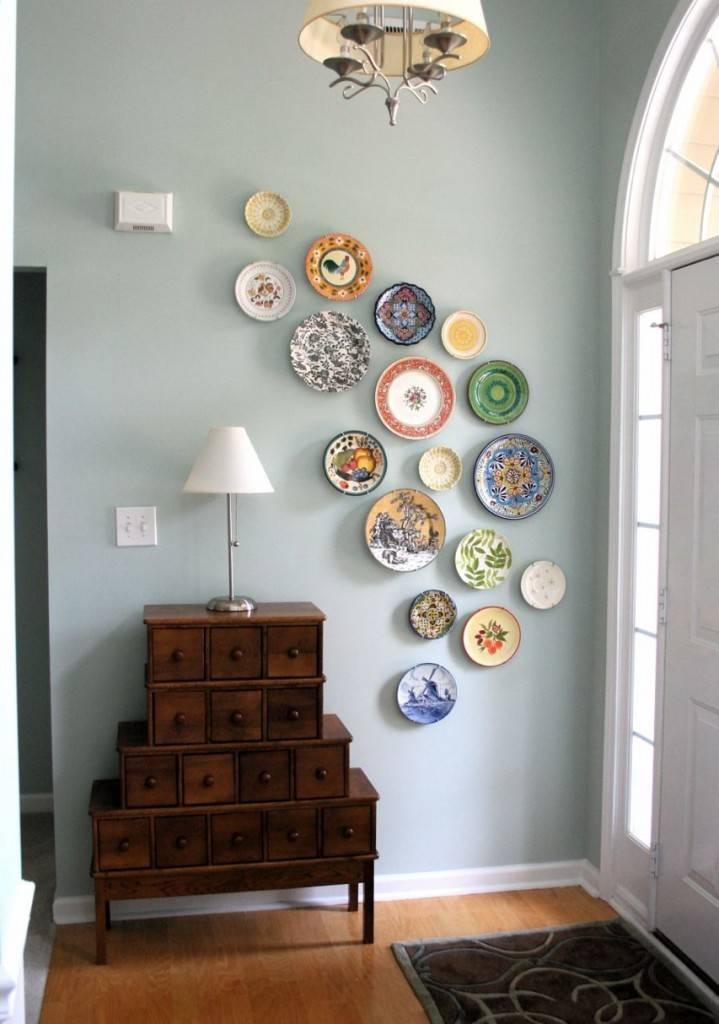Abstract wave of plates fills an odd wall space.