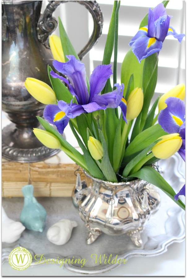 Silver vase with tulips and iris