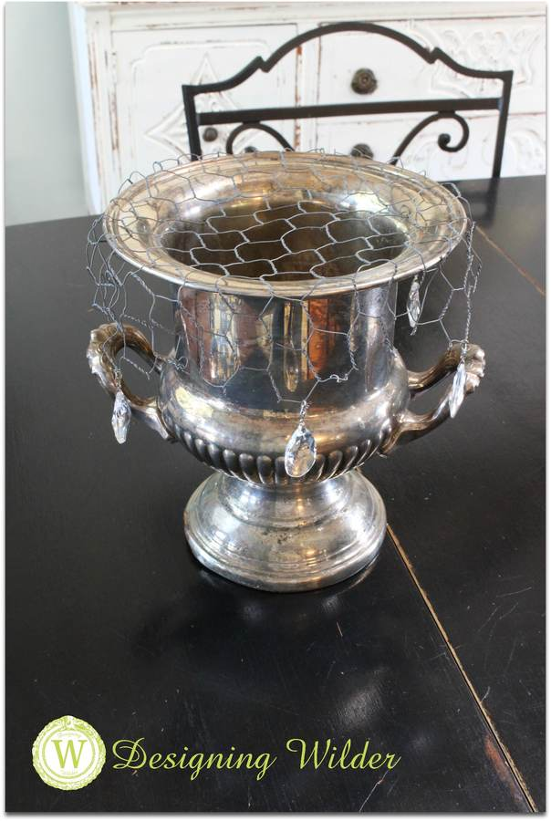 Trophy cup with decorated flower bonnet.