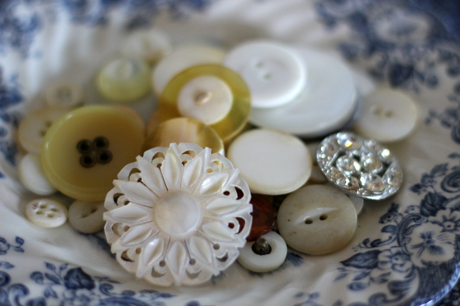 Vintage buttons add interest when thrown into a small bowl.