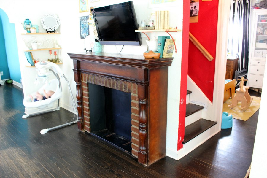 A salvaged surround gets a shabby fireplace update that turns it into the perfect architectural show piece in this eclectic boho bungalow.