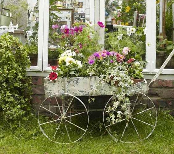 Flea market farm cart makes a fabulous piece of garden art for planting!
