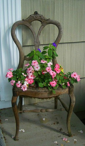 "Flea market chair provides the perfect ""seat"" for planting fun!"