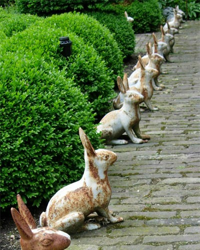 Flea market garden statuary always captures my attention! These cast iron bunnies are awesome! I love them used in multiples for impact!