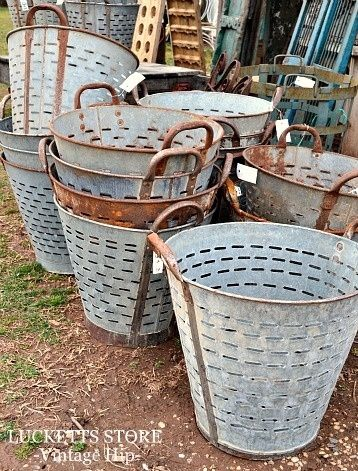 Flea Market olive baskets are all the rage! They can be used as light fixtures, organizational containers, or planters. They look especially good with small trees in them!