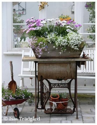 Flea market sewing machine cabinet provides the perfect venue to support a large planter!