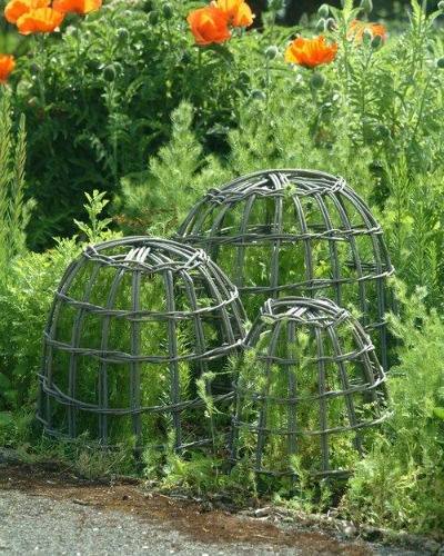 Flea market vendors offer a wide variety of goods. Be on the look out for hand crafted items like these willow cloches that are wonderful for protecting tender plants from being eaten by rabbits or stepped on by humans!