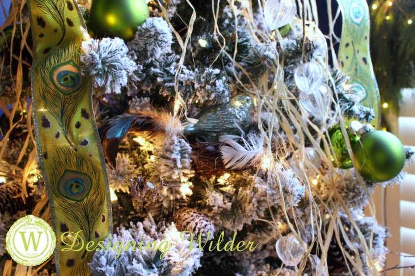 Christmas tree decor of ribbon, raffia, and glass birds, Christmas balls and weed pods.