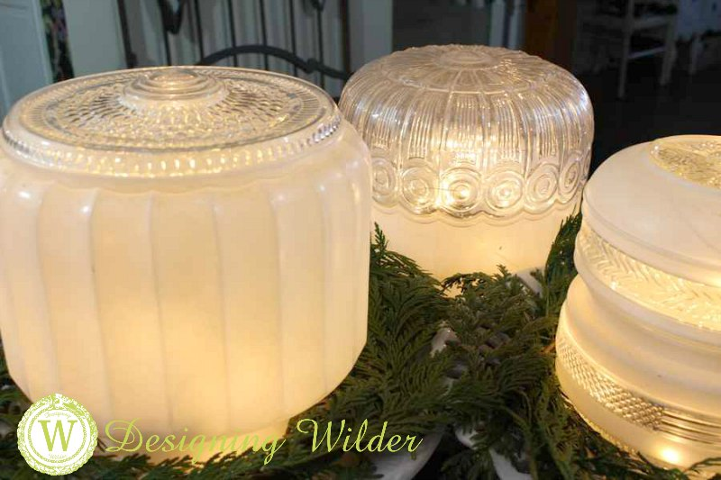 Vintage light globes combined with ironstone cake stands, greenery and battery powered fairy lights create a perfectly simple, unique Christmas centerpiece!