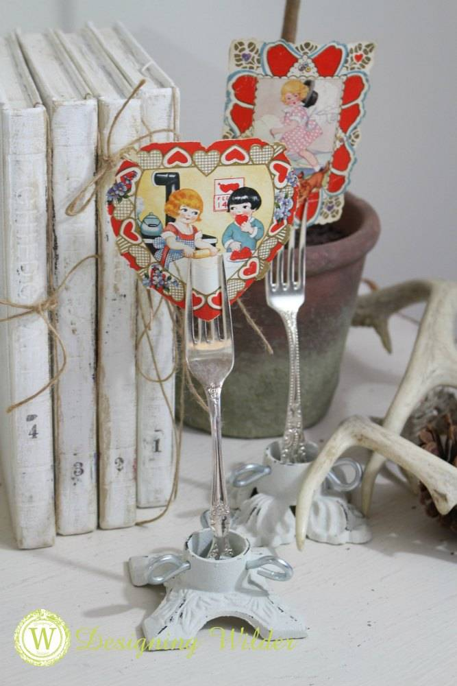 Vintage Valentines displayed using vintage silver forks.