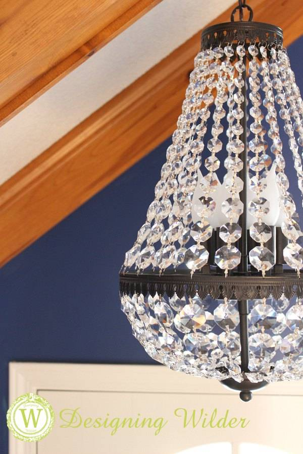 A good chandelier can make my heart skip a beat! This addition to our entry is the perfect combination of vintage style metal work and glistening crystals!