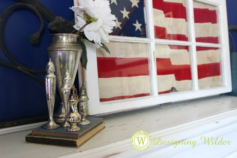"Summer decor goes ""Beach Cottage Patriotic"" by combining red, white and blue elements with treasures from the shore that speak of warm weather celebrations."